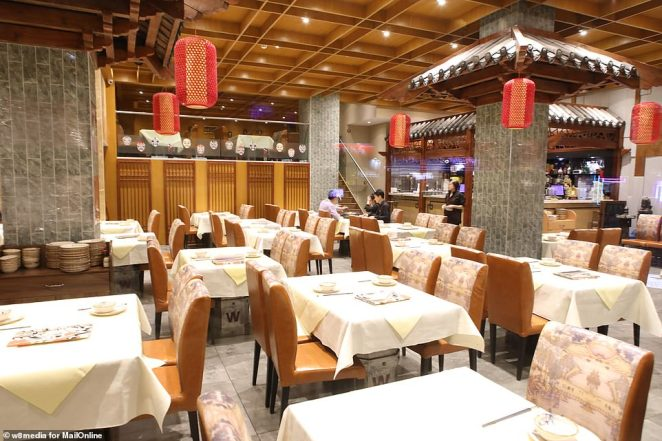 Just a week after that, there had been more than 800 confirmed cases and those same scientists estimated that some 4,000 – possibly 9,700 – were infected in Wuhan alone. By that point, 26 people had died. Pictured: An almost empty restaurant in Chinatown.There is no suggestion that restaurant staff are infected by the virus