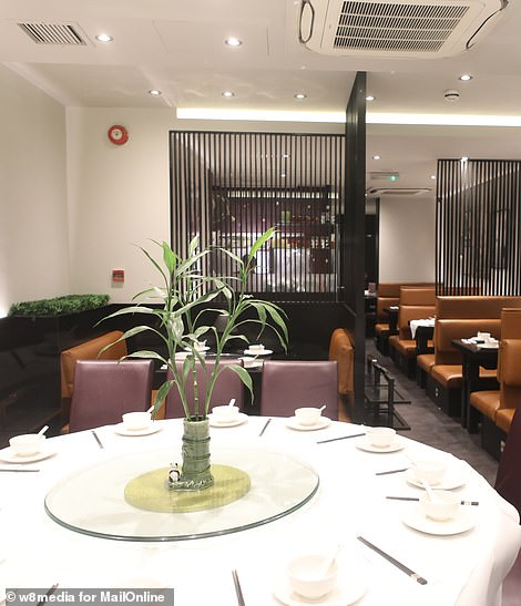 The latest case comes as all 83 people being held in quarantine at Arrowe Park Hospital in the Wirral were declared free of the virus and have been able to leave their accommodation. Pictured: A deserted restaurant in London's Chinatown.There is no suggestion that restaurant staff are infected by the virus