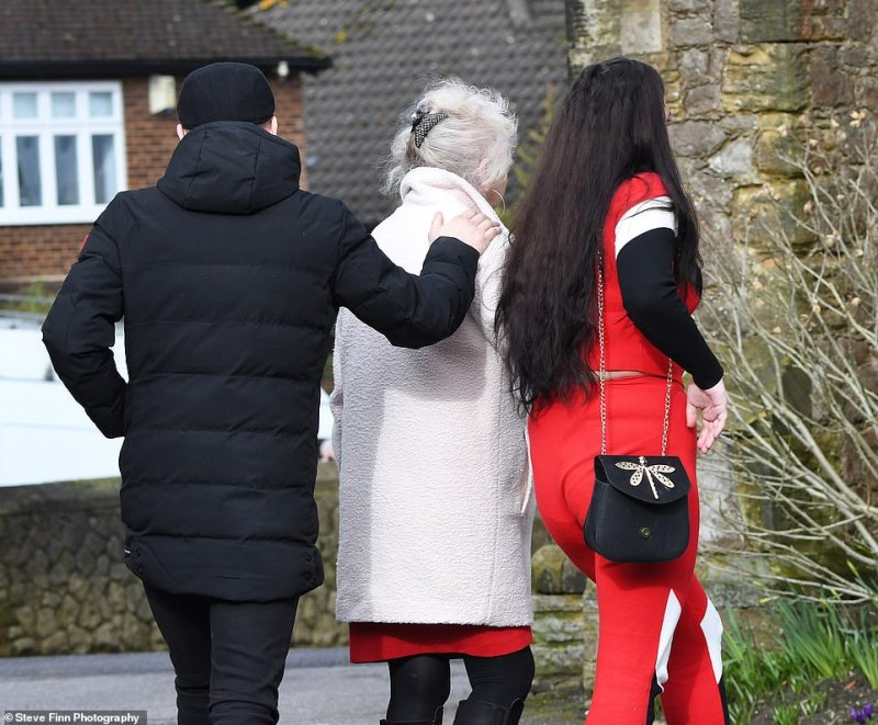 Mourners dressed in red and black to attend the service, which began to the sounds of 'He Ain't Heavy, He's My Brother' by The Hollies