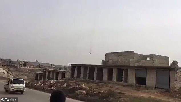 This footage was published by Syria's opposition forces today as they announced that they had shot down a helicopter belonging to the Assad regime
