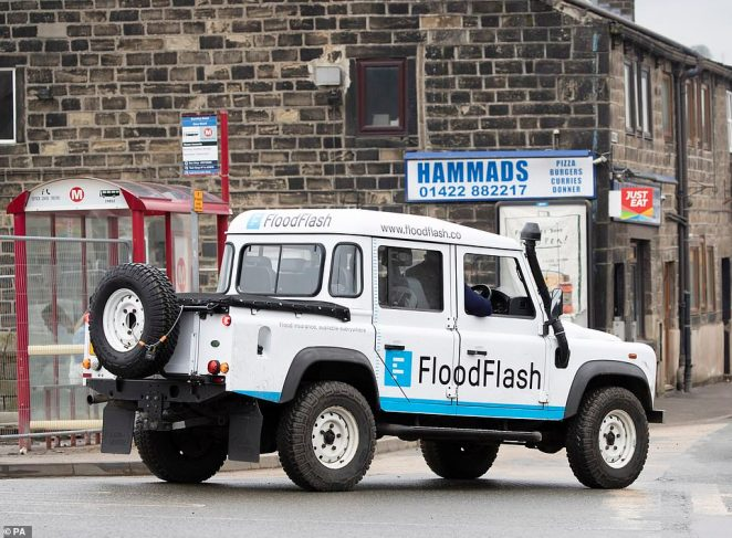 Flood-hit towns across the Calder Valley (Mytholmroyd pictured today) are loading up on sandbags as Storm Dennis threatens to batter Britain with even more rain and winds of up to 80 miles an hour tomorrow - just six days after Storm Ciara