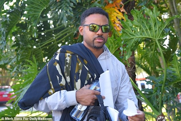 Security guard Dixon (pictured) is also expected to sue Stewart and his son in civil court but has yet to file an official complaint