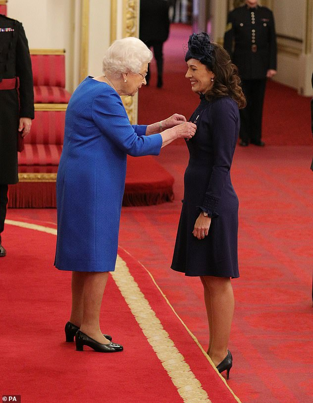 Marnie Gaffney from London, is made a Member of the Royal Victorian Order by Queen Elizabeth II at Buckingham Palace in an undated photograph. Deputy, assistant communications secretary Marnie Gaffney, is understood to be leaving