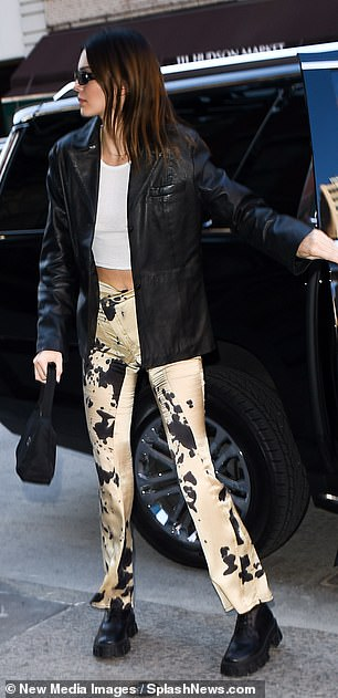 Street style: Kendall wore a leather jacket to keep out the chill