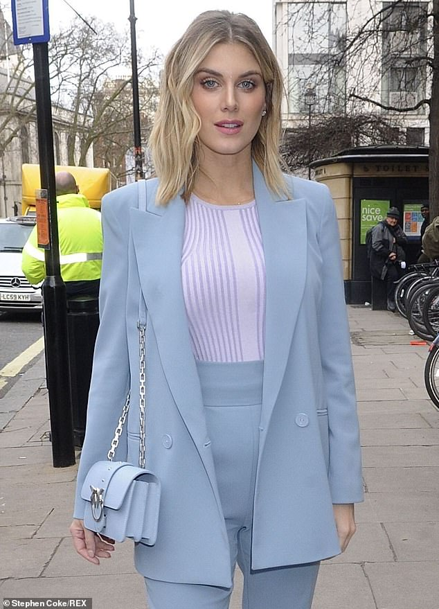 Dreamy:The model and DJ, 32, wowed in the pale blue two piece that she dressed down with a simple striped t-shirt worn underneath
