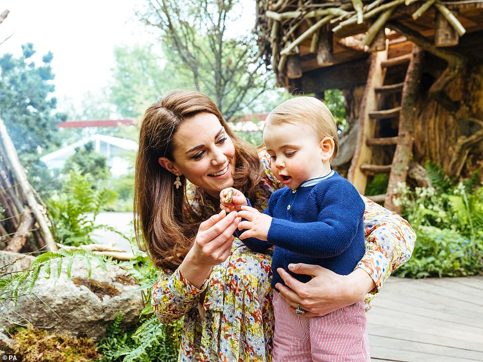 The Duchess of Cambridge with Prince Louis in the Adam White and Andree Davies co-designed 'Back to Nature' garden ahead of the RHS Chelsea Flower Show in London on 20 May 2019