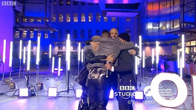 Happy: The band mates shared a sweet hug when they finished their performance and looked ecstatic