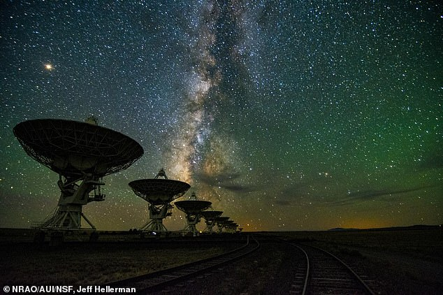 SETI scientist are developing a system that 'piggybacks' off the Very Large Array (VLA) telescope (pictured) based in New Mexico to identify anomalies in the stellar 'light curves' and listen for 'technosignatures' - both of which are signs of advanced alien civilizations