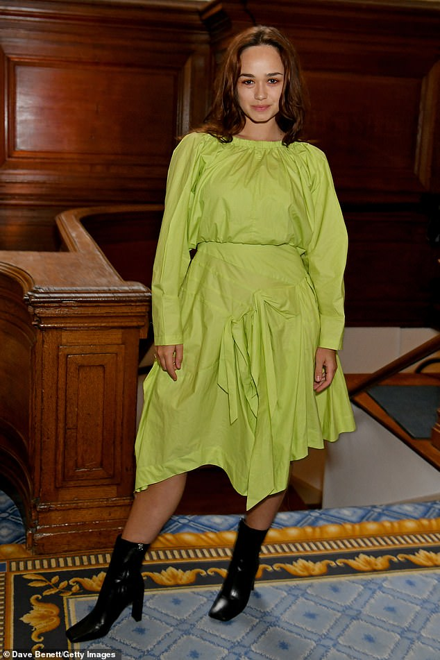 Turning heads:Rose Williams was sure to garner attention with her bright green dress