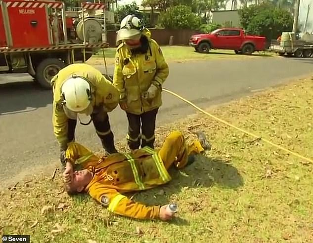 The Rural Fire Service said Mr Parker was tasked to take time off volunteer work because of exhaustion (pictured lying down on ground exhausted following rant) and the firefighter was never facing sack, but he claimed he was told he was finished