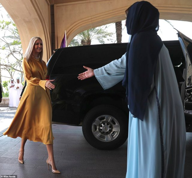 Ivanka is pictured greeting Lamia Abdulaziz Khan, executive director of the Global Women's Forum, after arriving at the forum on Sunday