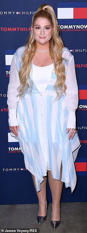 Figure flattering: The singer showed off her enviable curves by half buttoning her dress to create an hour glass silhouette