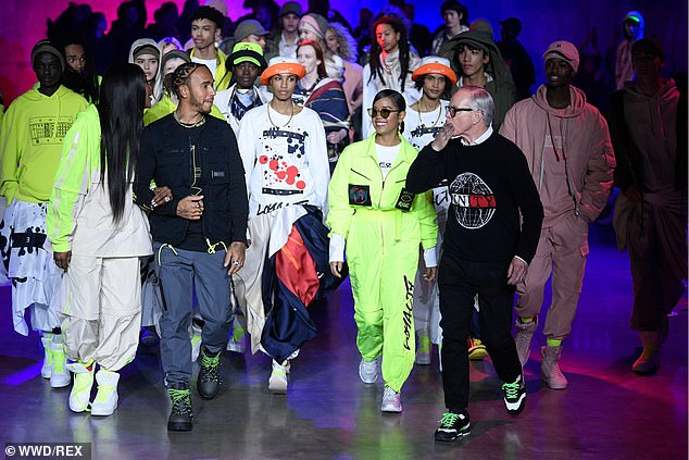 TommyNow: Upon the conclusion of the show, Hilfiger (right) walked out with his gang of models to thank the show attendees