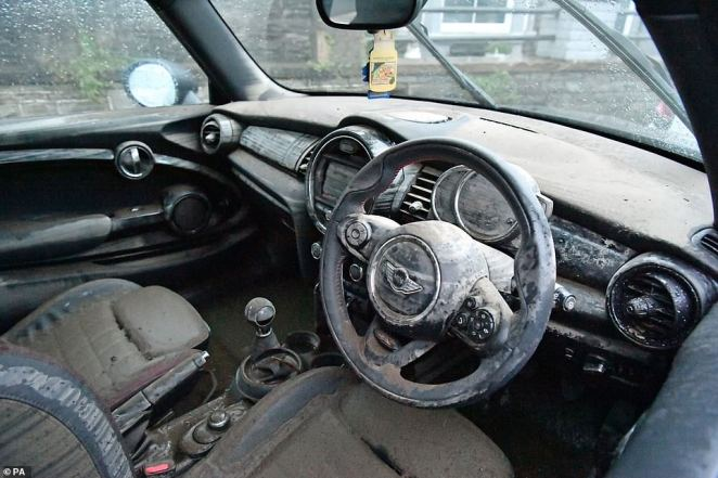 The water-damaged interior of a Mini car in Nantgarw, in south Wales.there are 54 flood warnings in Wales today, as police declared a major incident