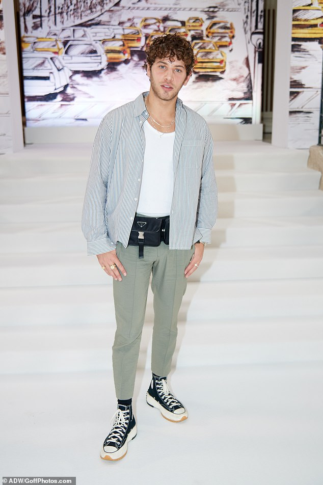 On trend: Love Island's Eyal Booker kept casual in a striped shirt and light olive trousers