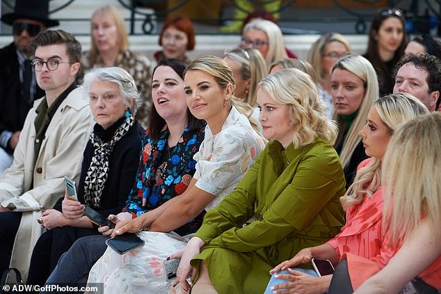 Strike a pose: Vogue looked deep in concentration as she joined a host of other celebrities on the front row of Paul Costelloe's show