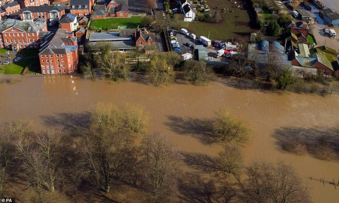 Flooded fields encroach on homes in Hereford, Herefordshire, which is one of the areas worst-hit by Storm Dennis