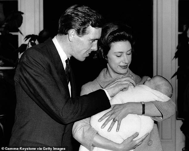 Lord Snowdon and Princess Margaret with their son David, in Kensington Palace on November 30, 1961