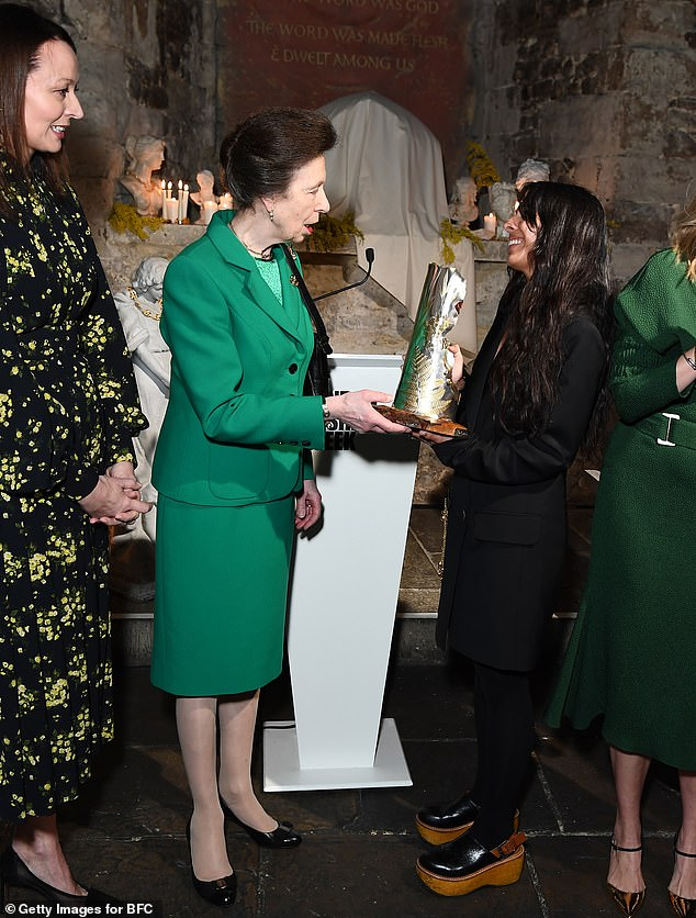 Anne presenting the award to Mahtani, whose Alighieri jewellery brand is inspired by Dante Alighieri¿s Divine Comedy. It marked the royal's first outing to London Fashion Week