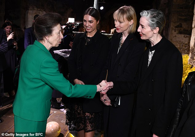 The royal was introduced to models (left-right) Yasmin Le Bon, Jade Parfitt and Erin O'Connor