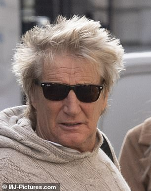 Arriving at 1.20pm, Rod Stewart enters salon in sunglasses