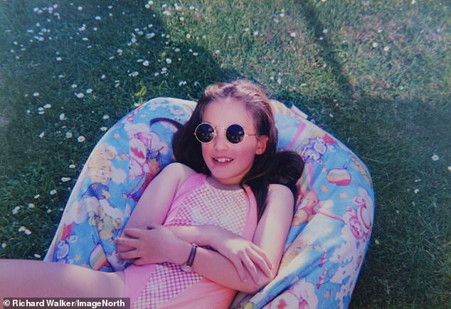 Sophie's parentshope to persuade the Government to enshrine in law tighter controls of reality TV shows. Pictured: Sophie Gradon, aged 7, on holiday