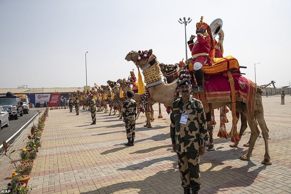 Security forces and their camels greet President Donald Trump and Indian Prime Minister Narendra Modi as they arrive at the Namaste Trump event