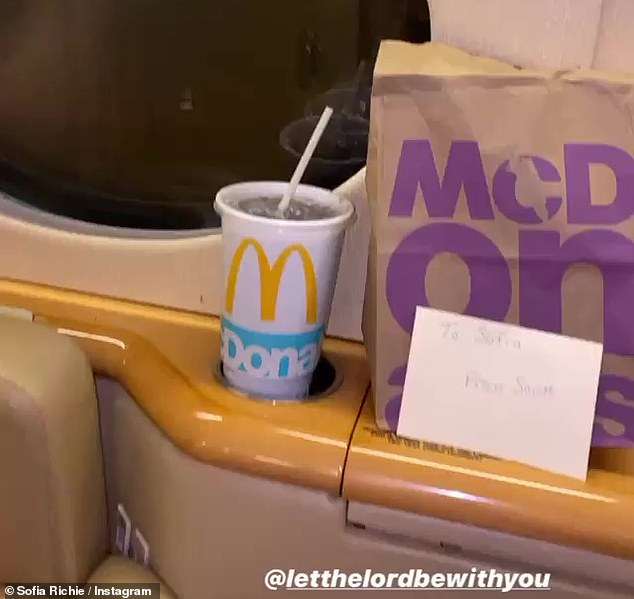Tasty: She shared a closeup of the fast food bag and drink, which were waiting by her seat as she climbed aboard