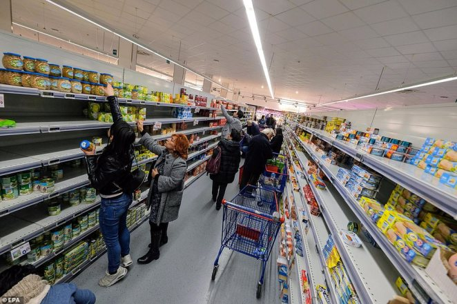 Shoppers in the Sicilian capital raided shelves for supplies amid fears the region may be locked down to stop the spread of coronavirus, after the city's first confirmed case