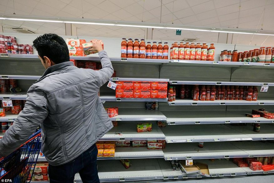 Italy registered ten new cases of coronavirus on Tuesday, but news that the disease has spread to the country's south will come as a hammer-blow to health officials trying to contain it (pictured, panic-buying in Palermo)