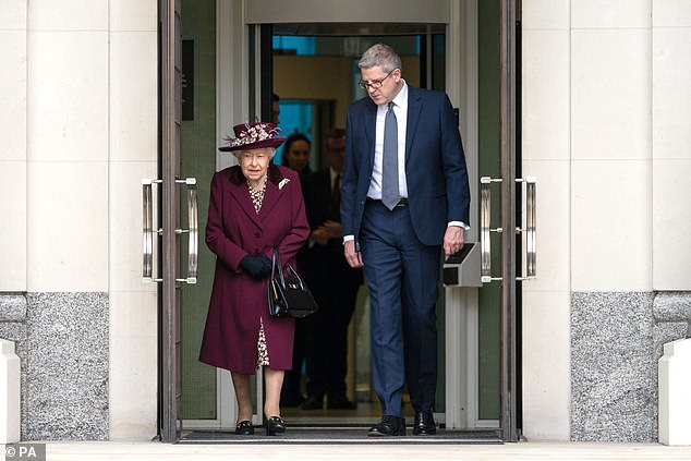 The monarch donned an elegant plum ensemble for the low-key outing to Thames House. She delivered a speech to staff before being escorted out by the Director General, pictured
