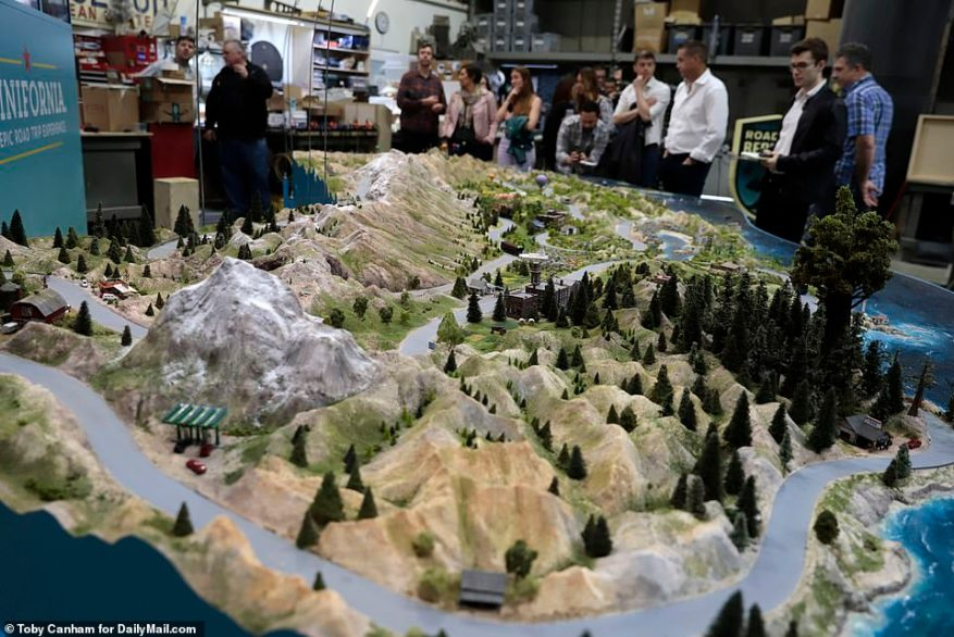 The model features miniature versions of the state's best-known landmarks including Disneyland, the Golden Gate Bridge, Sequoia National Park and Coachella Festival