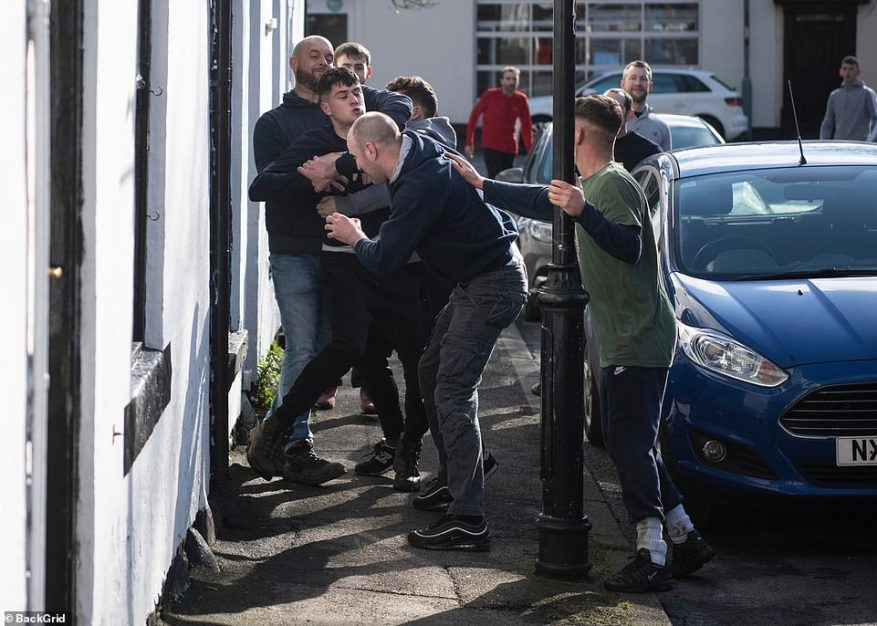 Hundreds also took part in their own version of a brutal Pancake Day game in Sedgefield, County Durham as residents were seen tussling for a ball