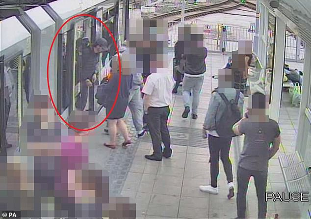 Abedi leaving a Metrolink train as he makes his way to the Manchester Arena in May