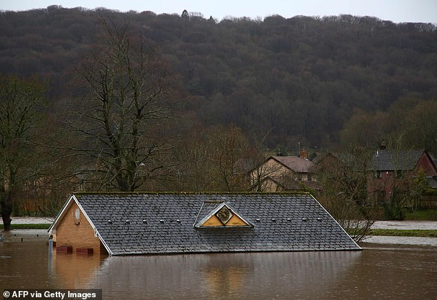 Flood water surrounds the bowling club after the River Taff burst its banks in Taffs Wells, north of Cardiff in south Wales this morning