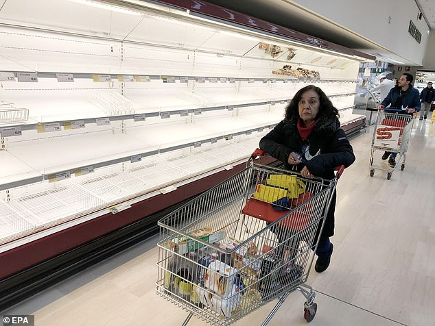 Empty shelves are pictured in a supermarket near Milan in the Veneto region of Italy, which is infested with coronaviruses. Survival teacher Bob Cooper warned of panic buying, but said the Australians should start buying certain dried foods
