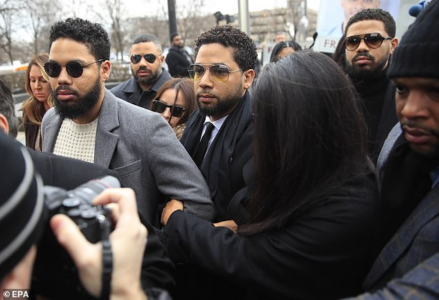 Jussie Smollett arrives at Cook County courthouse on Monday with his brother, Jocqui (left), Jojo (far left) and Jake (right) to face six felony counts of lying to police