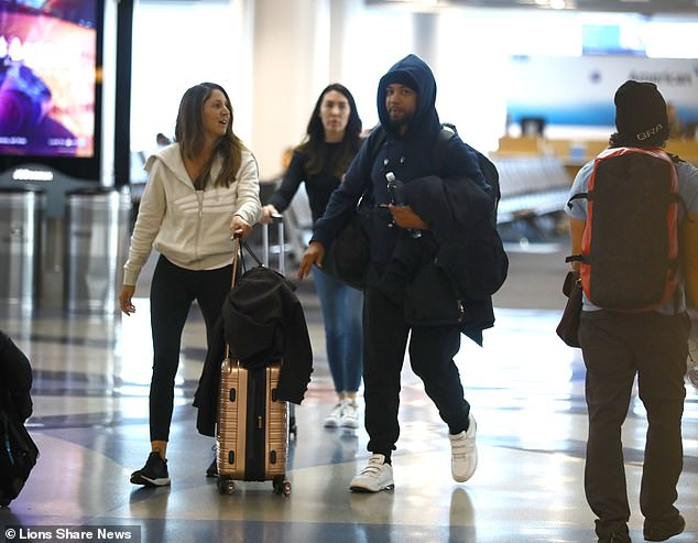 Smollett was picturedarriving into Los Angeles on Tuesday with his lawyer Tina Glandian