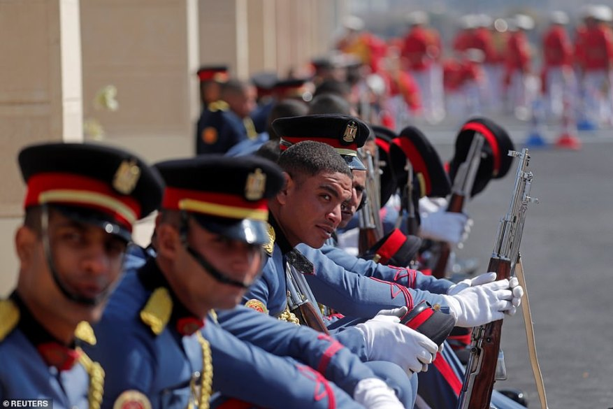 Guards wait for the start of former Egyptian President Hosni Mubarak's funeral at Field Marshal Mohammed Hussein Tantawi Mosque east of Cairo