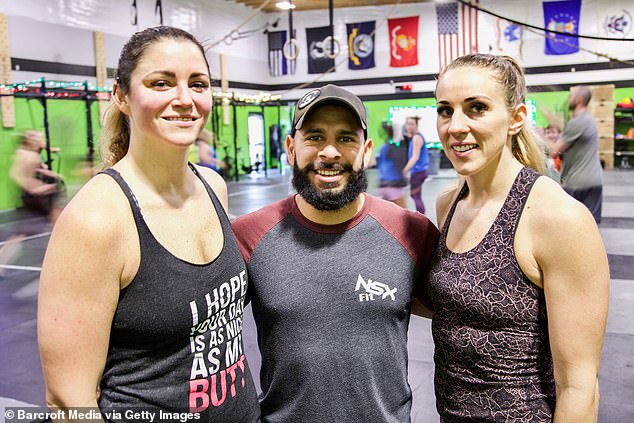 As they spent more time together, their friendship blossomed into a romantic attraction and they formed a thruple in September 2016. Pictured together in their gym (Mary left, Kim right)