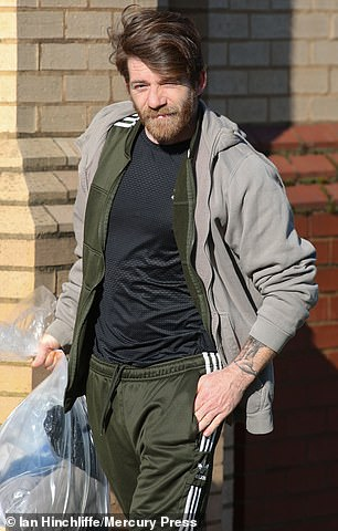 Manley leaves Sefton Magistrates Court in February last year after being released on bail