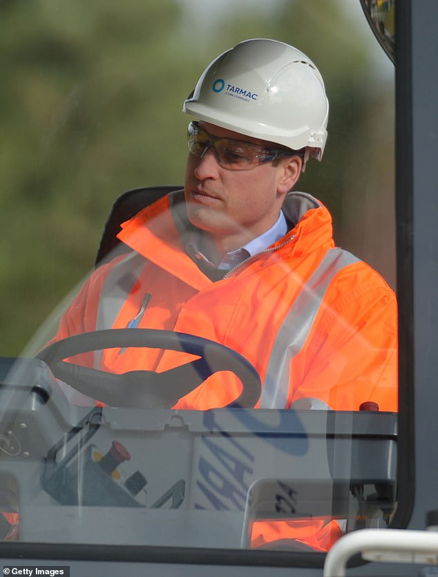 After heading outside, Prince William donned a hard hat and protective glasses as he operated an Asphalt Paver