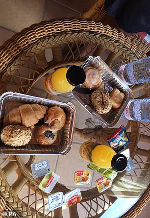 Atray of bread, pastries and orange juice