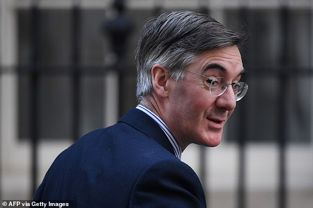 Some social media users accused Mr Rees-Mogg, pictured in Downing Street yesterday, of staging the crisps photo