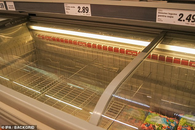 An empty freezer drawer at a supermarket in Romania, which confirmedits first case on Wednesday - a man who was in contact with an Italian who visited the country last week