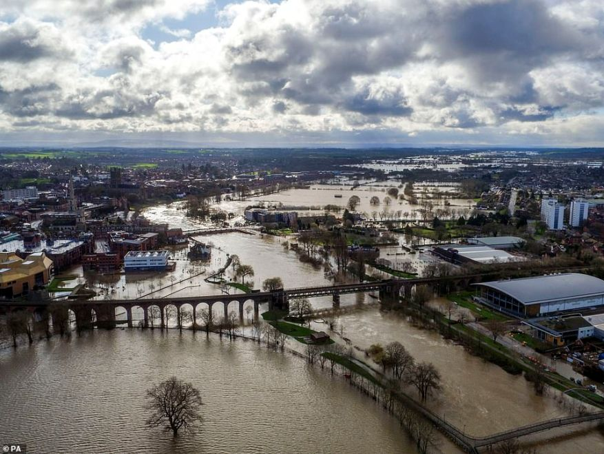 Flood water surrounds Worcester city centre today as residents in riverside properties in the area have been told to leave