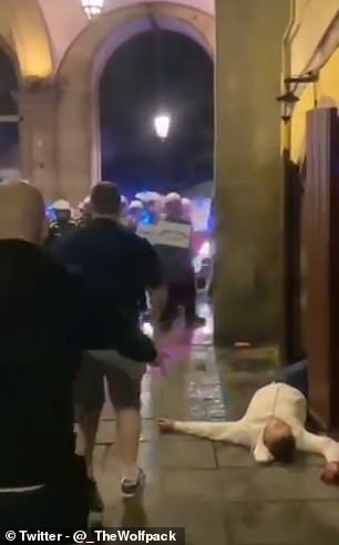 One supporter was seen lying on the ground unconscious following the late-night clashes