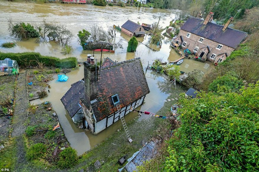 Flooding in Ironbridge, Shropshire, today as residents in riverside properties in the area have been told to leave their homes