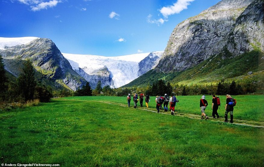 Hikers advance towards the colossal Jostedalsbreen glacier, which is the largest glacier in mainland Europe, according to Visitnorway.com. The glacier covers almost half of Jostedalsbreen National Park, the site says