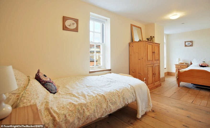 Wooden floors bring a traditional feel to the property's stunning bedrooms, of which there are four across the house
